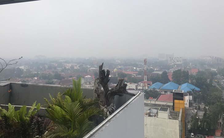 Asap Selimuti Kota Pekanbaru