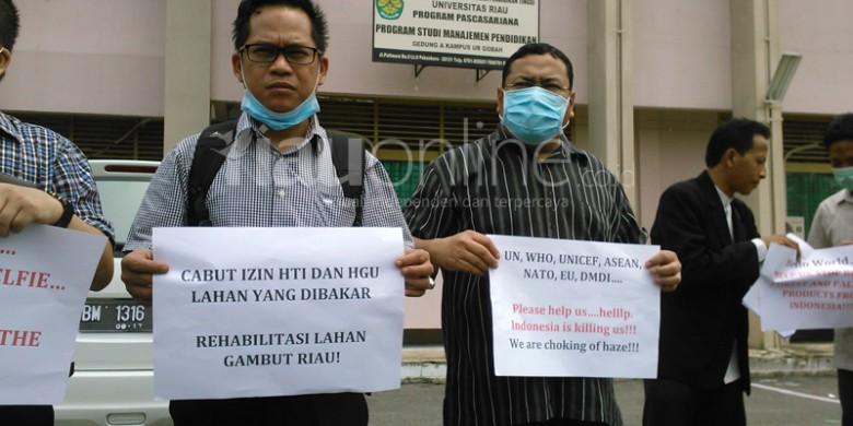 Asap-Genosida-Melayu-Riau.jpg