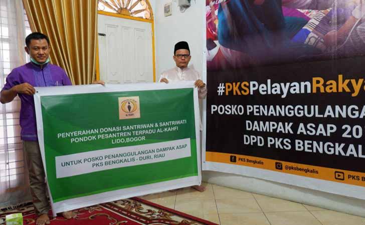 Bantuan-Santri-ke-Warga-Riau.jpg