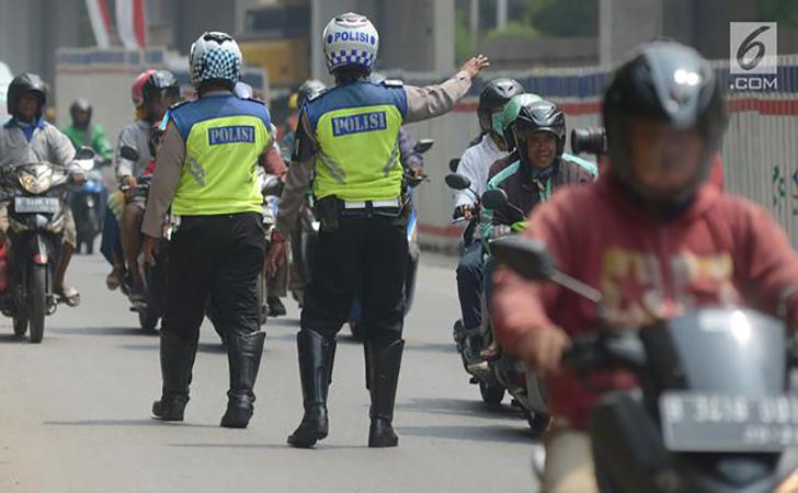Ilustrasi-polisi-lalulintas-sedang-bertugas.jpg