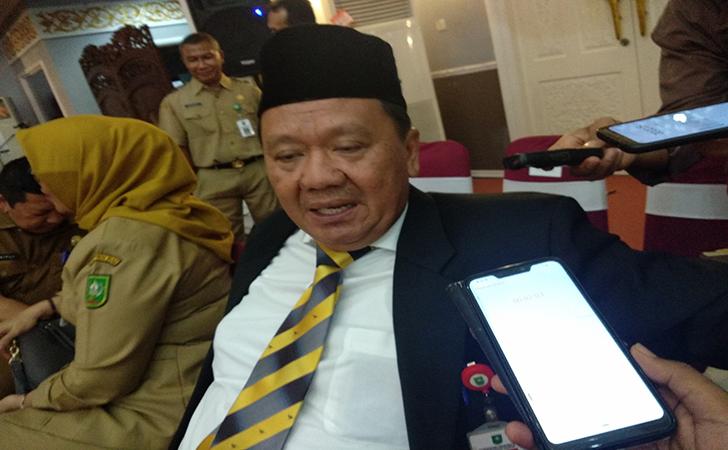 Kepala-Dinas-Ketenagakerjaan-Provinsi-Riau-Jonli.jpg