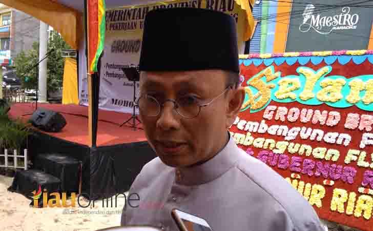 Ketua-OJK-Riau-Yusri.jpg
