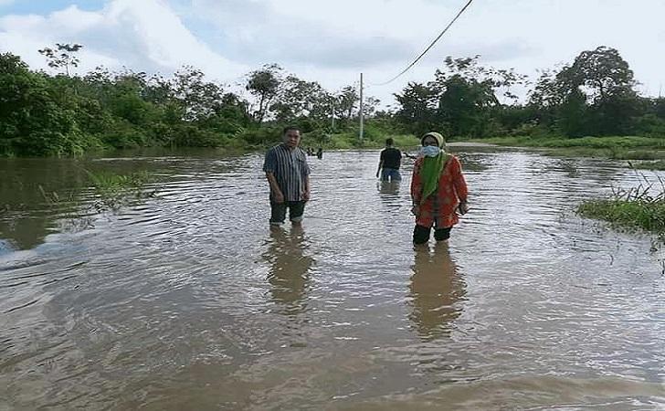 banjir-bunut.jpg