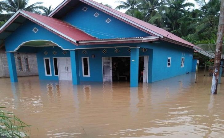 banjir-kuansing-rendam-pemukiman.jpg