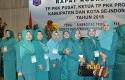 KETUA-TP-PKK-Kabupaten-Kampar-Nuraini-Azis-bersama-pengurus-lainnya.jpg