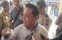 Kepala-Disnakertrans-Riau.jpg