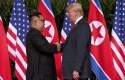 Trump-dan-Kim-berjabat-tangan.jpg